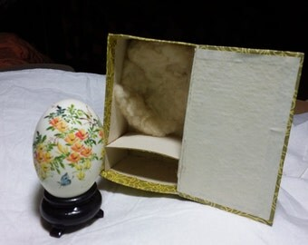 Vintage hand painted egg. Has a stand and comes with its original box. Beautiful flowers and butterfly
