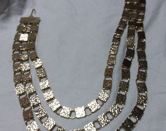 Triple strand unusual vintage necklace gold high gloss. Estate found costume jewelry.