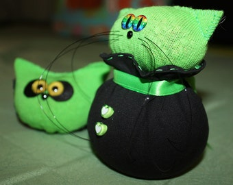 The bright green and black kitty and owlie - a couple of  Charming Plushie toys.