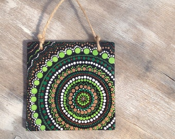 Mesmerizing Green dot art painting on ceramic