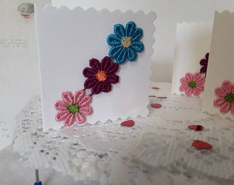 Four very cute little gift tags/cards with 3 embroidered coloured flowers and matching envelopes