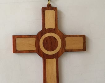 Wooden cross pendant with central circular feature, 2 colour