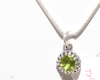 Facetted Peridot stone in Sterling Silver backing