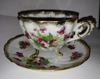 Footed cup and saucer