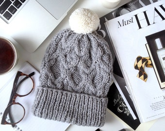 cute knitted beanie hat with pompom
