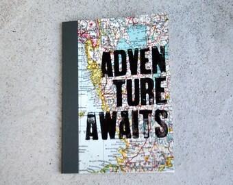 ADVENTURE AWAITS DinA6 notebook Atlas travel book