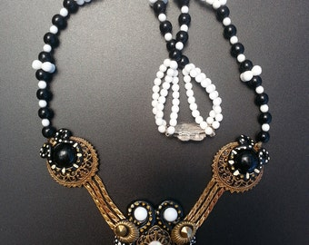 Skull neclace,1940 brass stamping s,mother of pearl,black and white 3 strand beads brass 1940 s chain