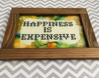 Happiness is Expensive - Hand made cross stitch in wood frame