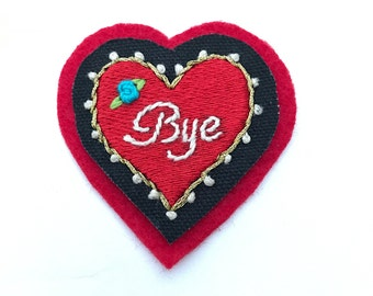 Heart shaped red 'Bye' patch. Hand embroidered.
