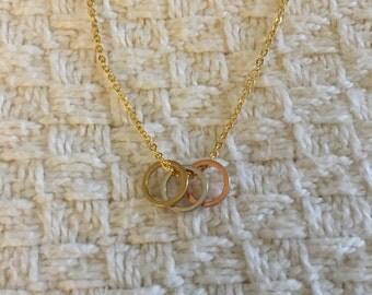 Tri-color 8mm circle necklace; matte gold chain; gold tone, silver tone, and rose gold tone circles;