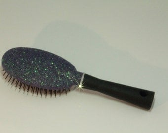 Glittered hairbrush with crystal collar