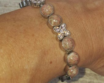 Beautiful bracelet with diamante stones set in silver settings with pink marbled stones
