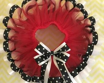 Red tutu with black and white polka dot trim