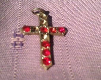 silver cross, red jewels (appraised)
