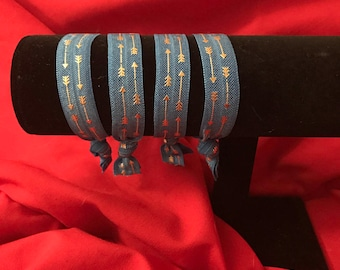 Blue with gold arrow hairties