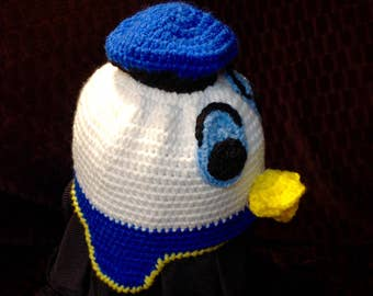 White duck with blue hat beanie