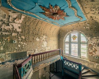Fine art photography by a staircase in an abandoned Castle in Europe