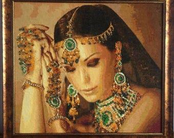 Cross stitch picture. She looks like Sri Lakshmiperfect Lord Vishnu's wife