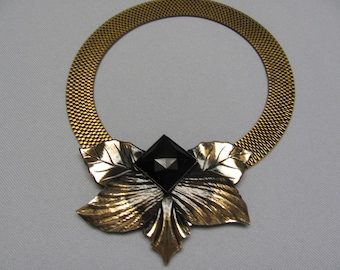 "Signed ""West Germany.""  Choker gold mesh.  Five leaves with black center diamond stone."