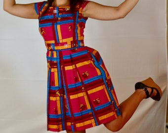 Embellished Ankara flirty summer African Dress with pleats for a better fit