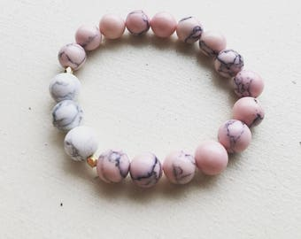 Pink and white beaded bracelet