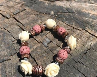 Pink lava rock essential oil diffuser bracelet with cream rose and sparkle accent