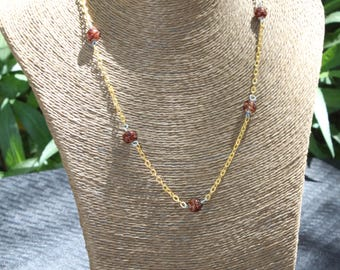 Elegant Gold Necklace with Brown Beads