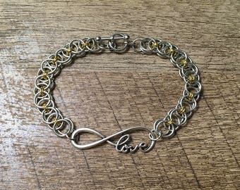 Silver and gold love bracelet.