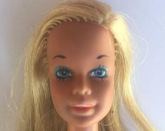 Vintage Barbie - Malibu Barbie from 1971 wearing Silver polish (1969)