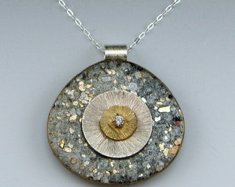 Small double disc polymer pendant on sterling chain