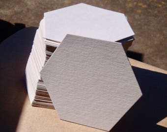 "50 blank hexagonal coasters 4"" x 4.75"", 100% recycled paper board"