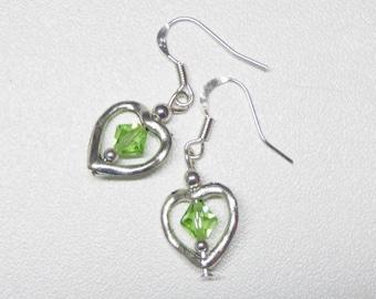 heart shaped dangle earrings with green swarovski crystals,green crystal dangle earrings,heart dangle earrings,silver dangle earrings