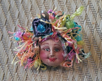 Colorful, whimsical fiber sculpted art doll face pin, silk face, designer yarn hair, Swarovski crystal accent