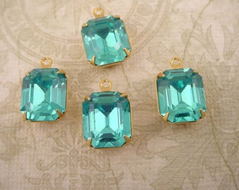 4 vintage glass aquamarine  aqua Octagon 12x10 stones in closed  back brass setting 1 ring charms