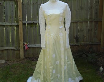Late 1960s or early 1970s ecru silk and white flower lace vintage wedding dress size 6 with lace sleeves and cathedral train