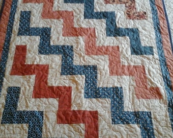 Rust and navy toddler quilt