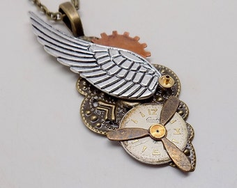 Steampunk jewelry. Steampunk angel wing necklace pendant with gears.