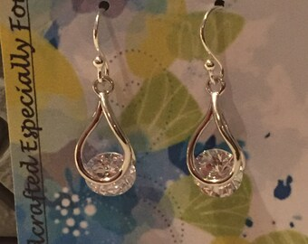 Beautiful Clear CZ set loosely in a Teardrop Casings, Silver Earrings