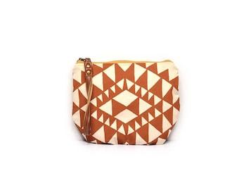 wristlet clutch • wrist strap • geometric triangle print - terra cotta orange - triangle geometric print - summer fashion - boho