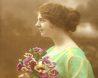 1900s French postcard, Lady in green with pansies, RPPC real photo postcard, paper ephemera.