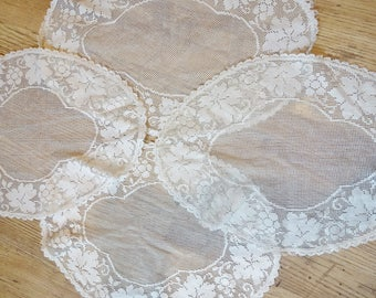 Four matching vintage oval lace mats