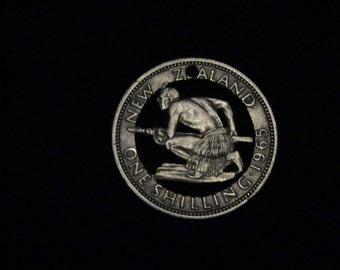 1965 New Zealand - cut coin pendant - w/ Maori Tribesman Hunter
