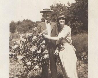 Original Vintage Photograph Snapshot Man & Woman Pose Outdoors by Flowering Bush 1922