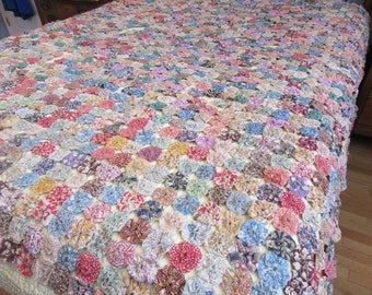 REDUCED.Large antique hand sewn yo yo quilt- beautiful needs some TLC to repair separated yoyos- great project to make beautiful  yoyo quilt
