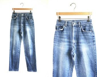 Vintage Distressed Denim Medium Wash LEE Woman's High Waist Tapered Leg Worn Out Blue Jeans