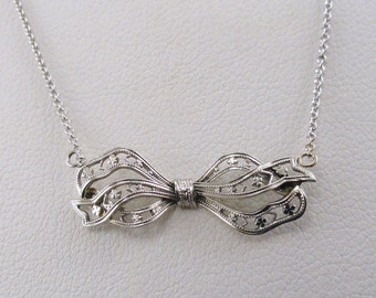 An Antique Filigree and Flowers Ribbon Pendant, White Gold, with Delicate Cable Link Chain (A1733)