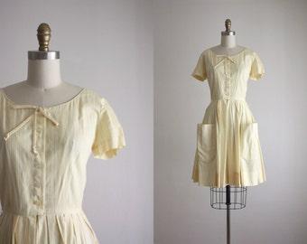 1950s lemon peel dress