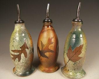 olive oil dispenser, leaf impressions, nature themed