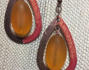 Orange frosted glass teardrop earrings, hammered copper