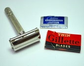 Vintage 1948 Gillette Super Speed double edge safety razor, turn handle to open, with vintage blades